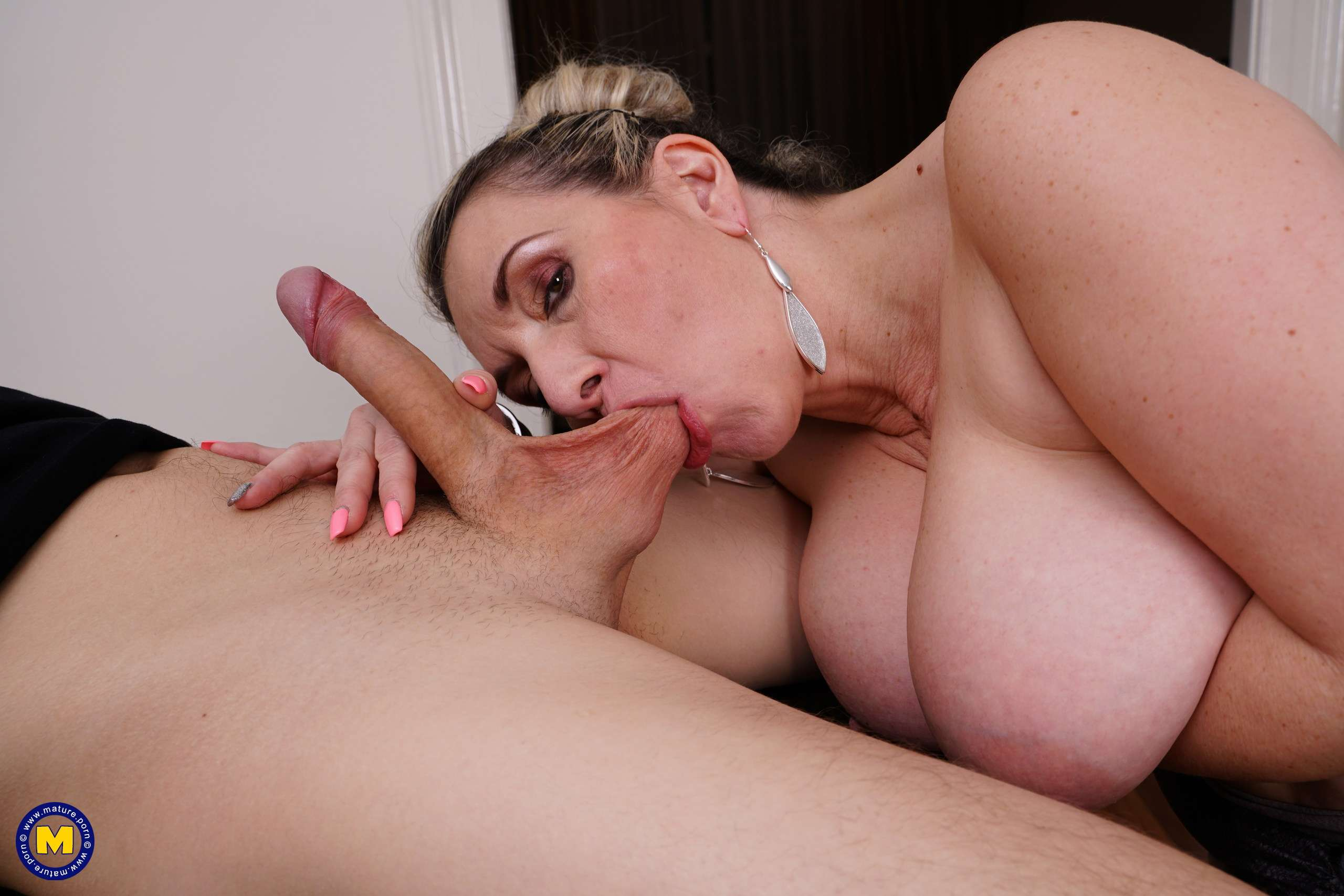 Big breasted German mature lady doing her toy boy