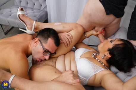 Naughty Mature Slut Getting A Double Penetration From Two Younger Guys