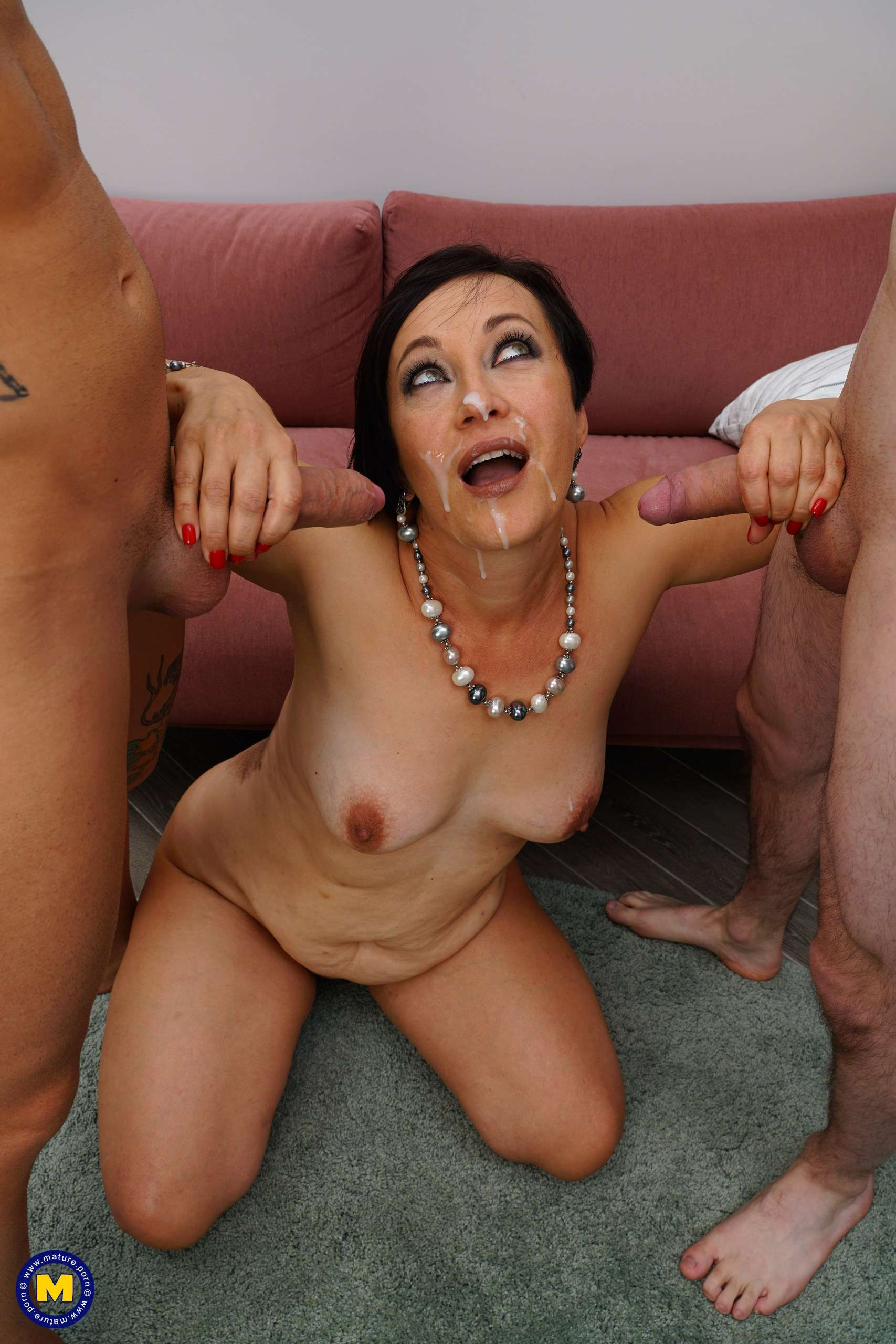 Hot mature getting a double penetration from two guys