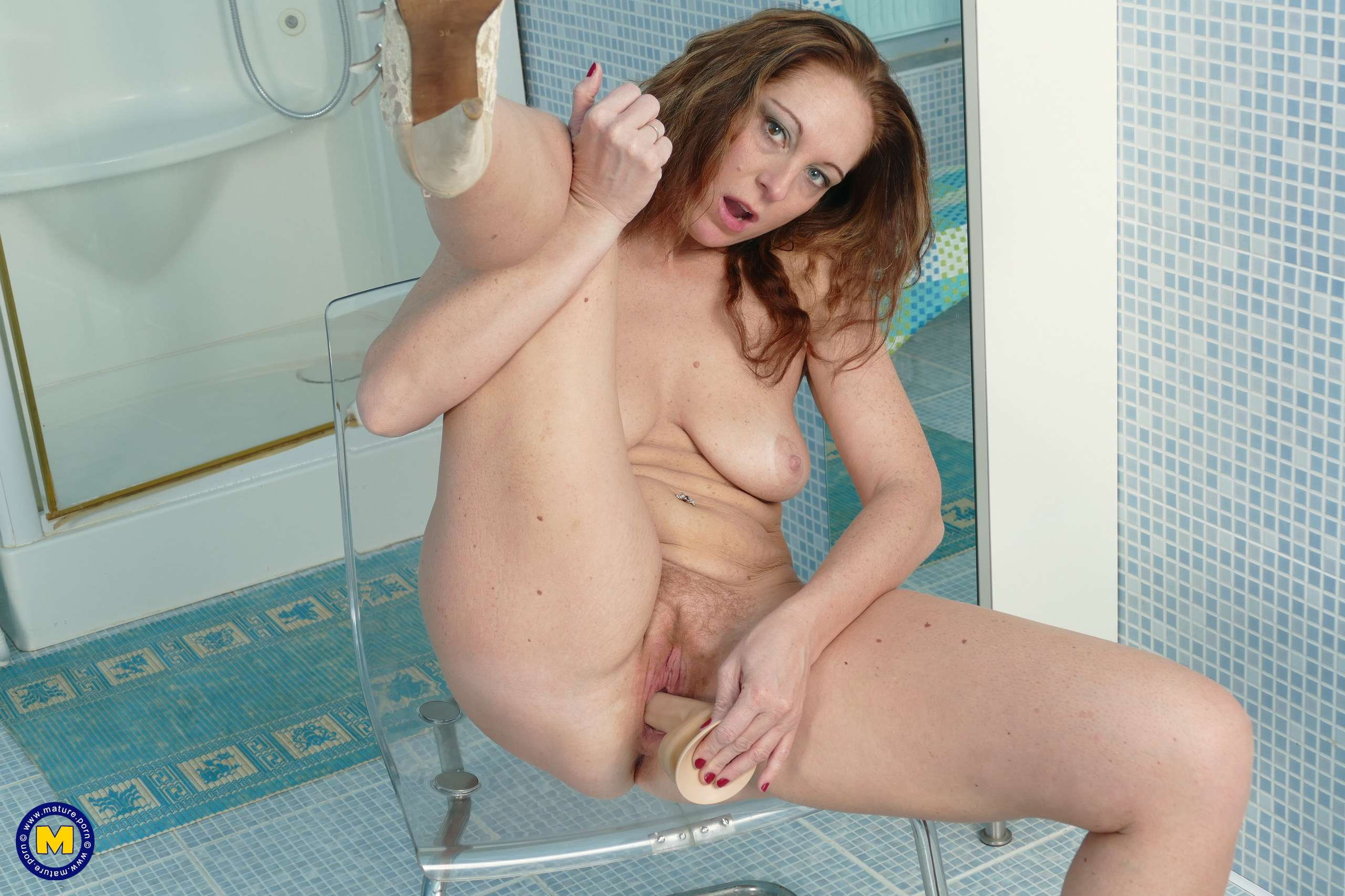 Unshaved housewife getting wet in her bathroom