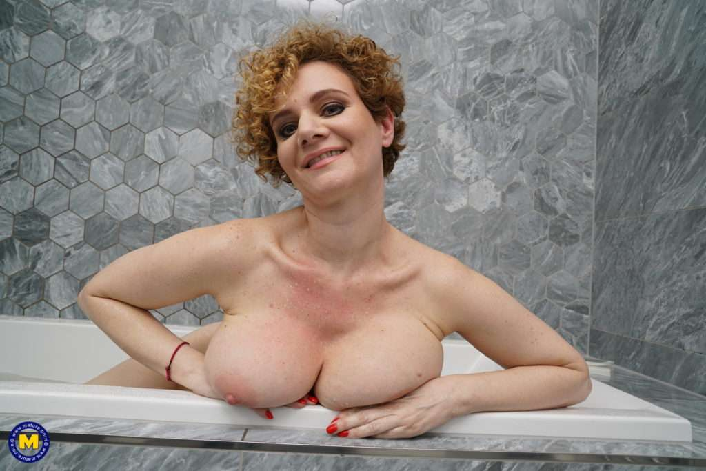 Big Breasted Hot Mama Playing In The Bathtub