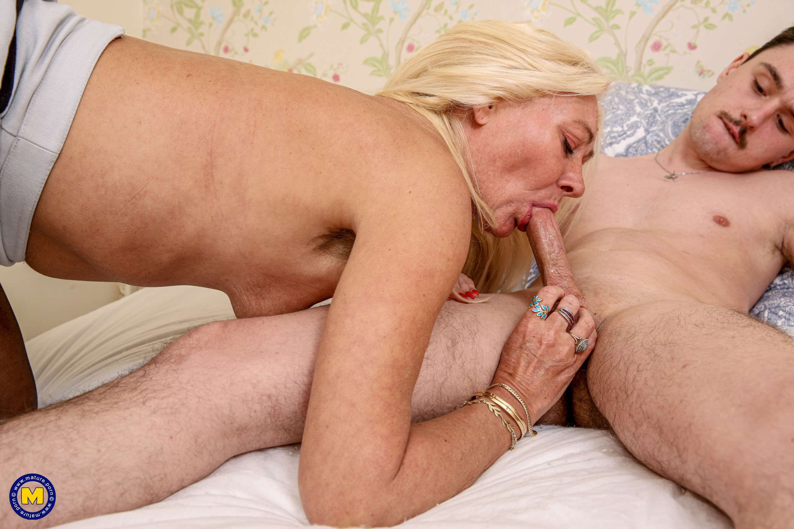 Horny hairy cougar sucking and fucking her toy boy