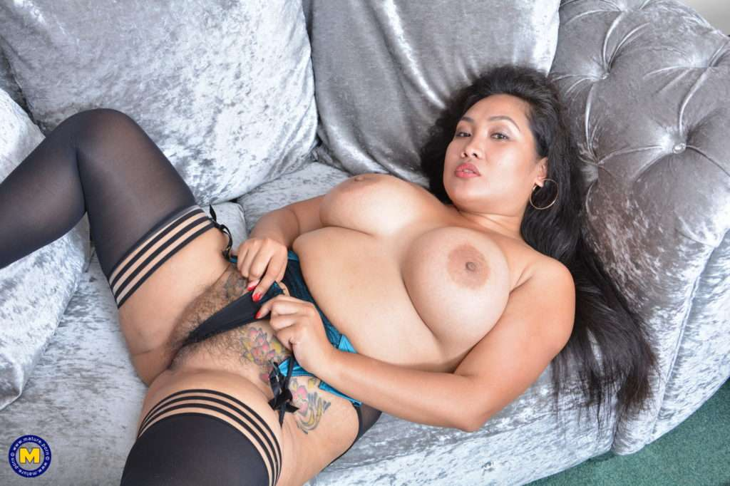 Big Breasted Asian Housewife Playing With Her Unshaved Pussy