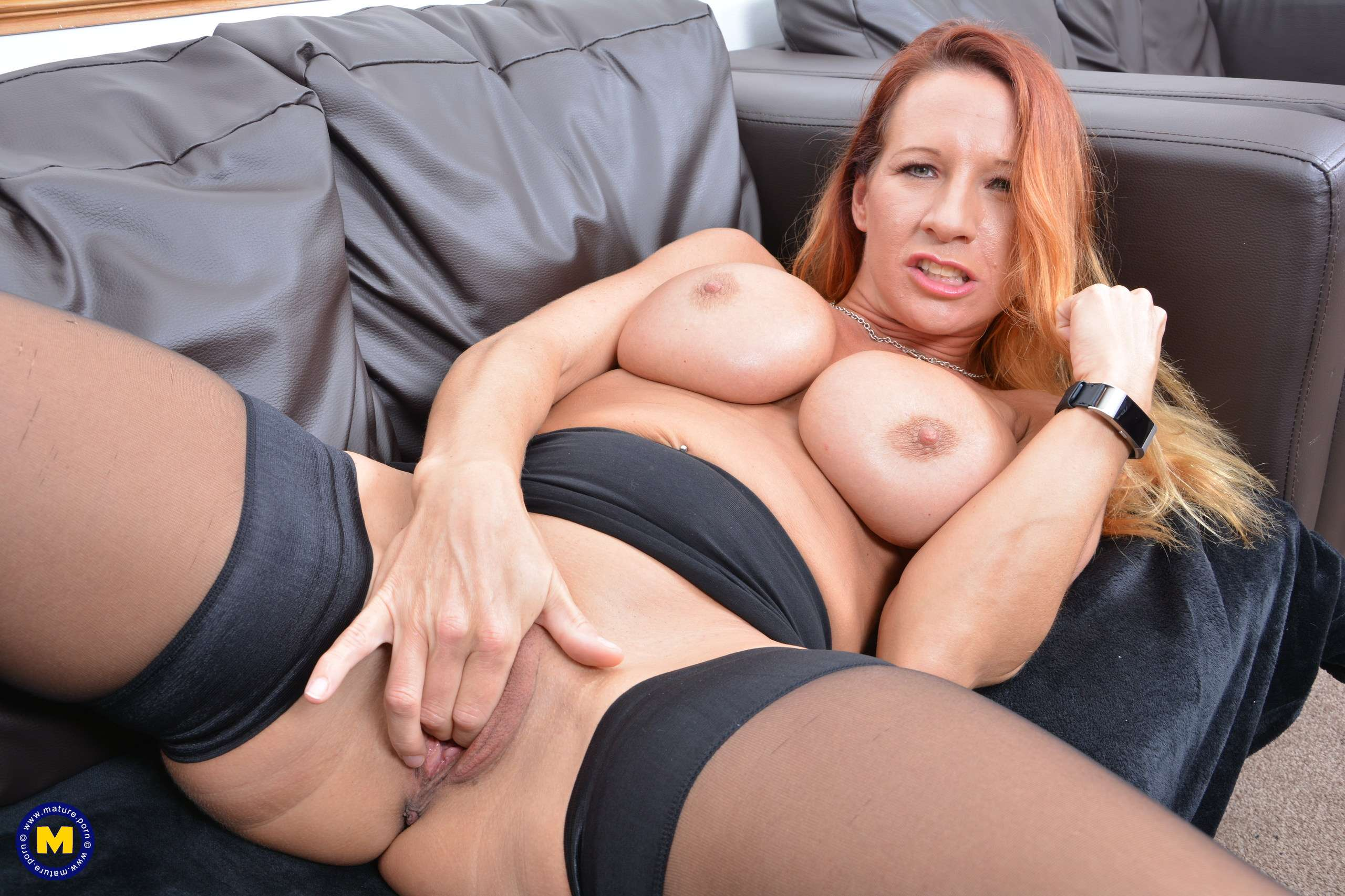 Naughty British MILF Faye plays with her pussy