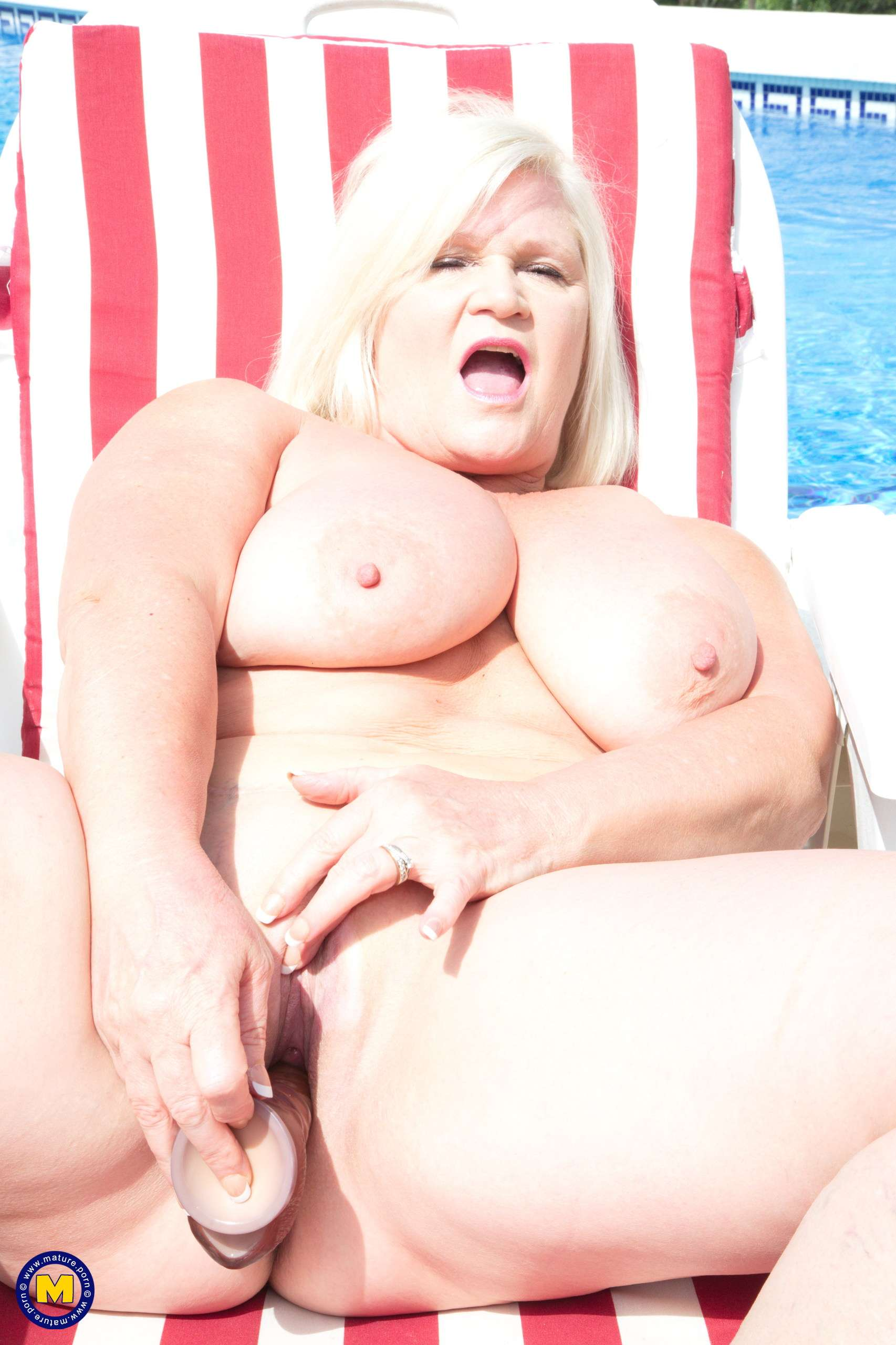 Big breasted Lacey Starr is playing with her pussy in the sun