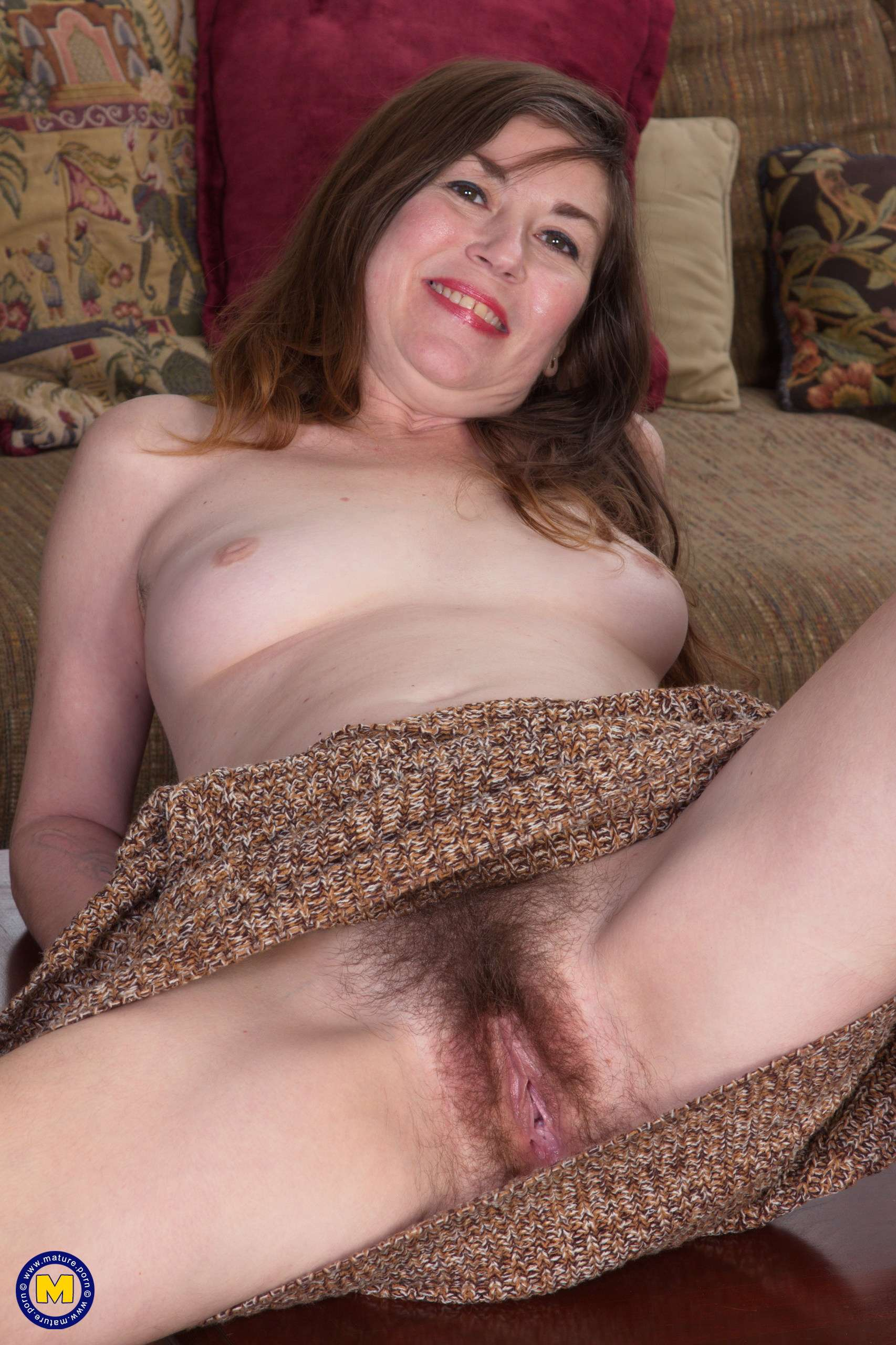Hairy American mature slut playing with herself