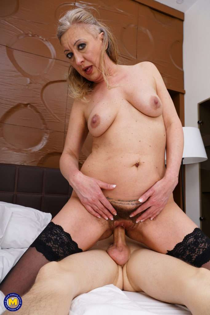This Naughty Toy Boy Gets A Hairy Mature Pussy To Please At Mature.nl