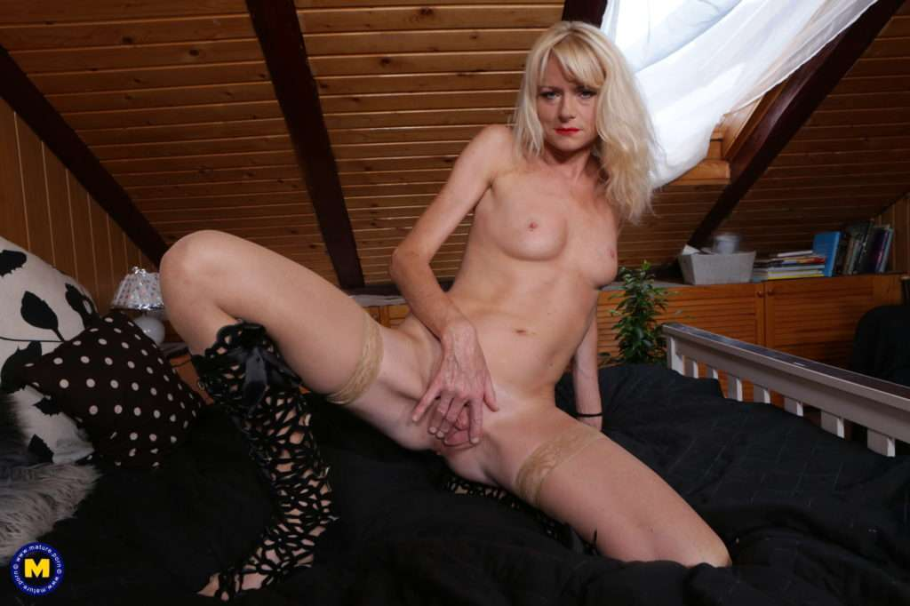 Naughty Blonde Milf Playing With Her Shaved Pussy At Mature.nl