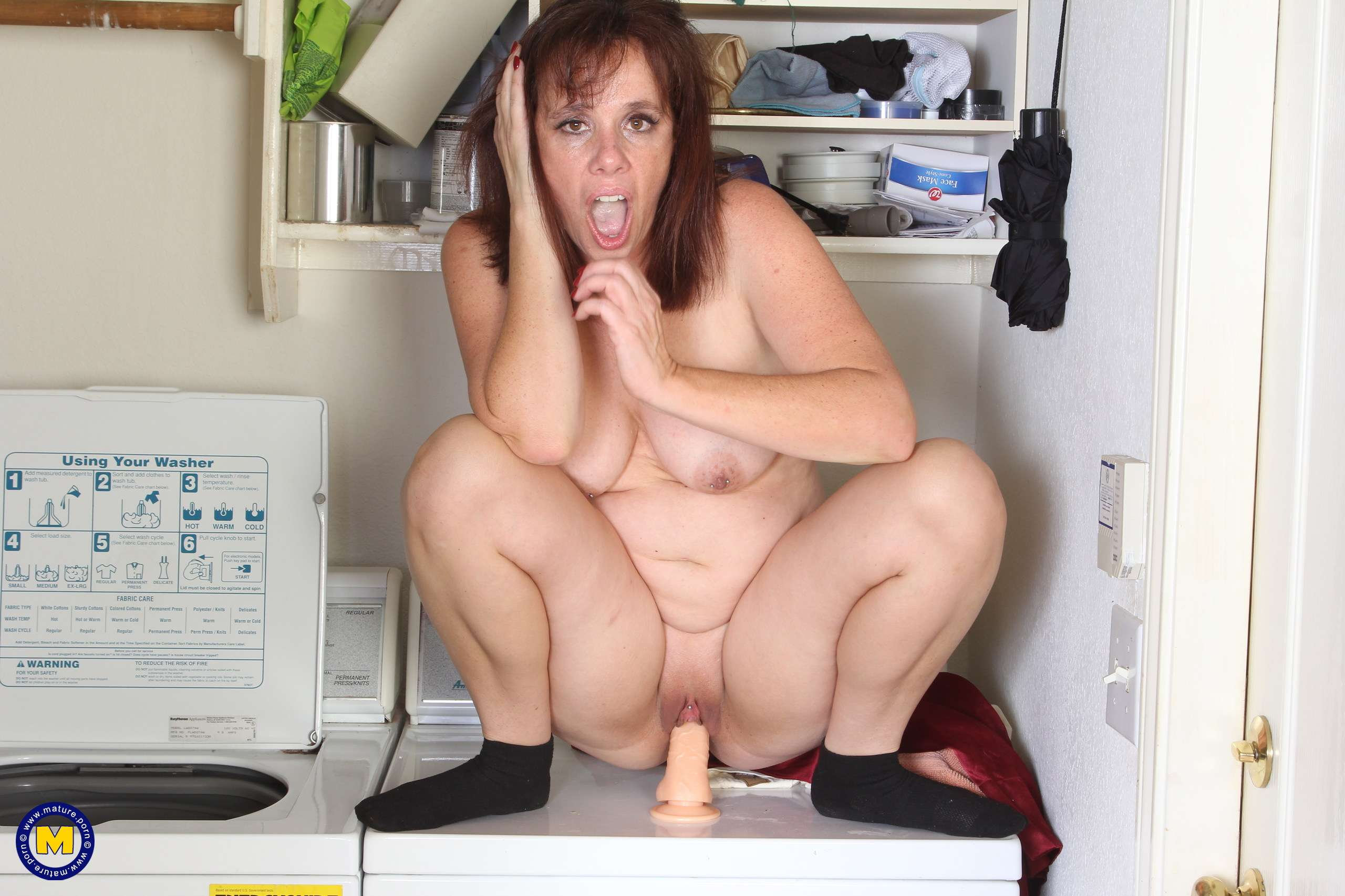 Naughty American slut playing around in the laundry room