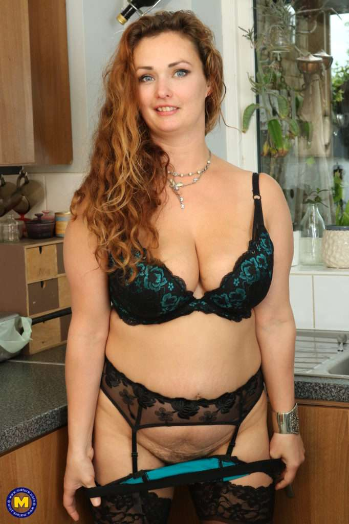 Horny Curvy Milf Playing With Herself In The Kitchen At Mature.nl