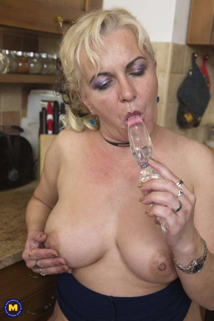Horny Housewife Playing With Her Wet Pussy In Her Kitchen At Mature.nl