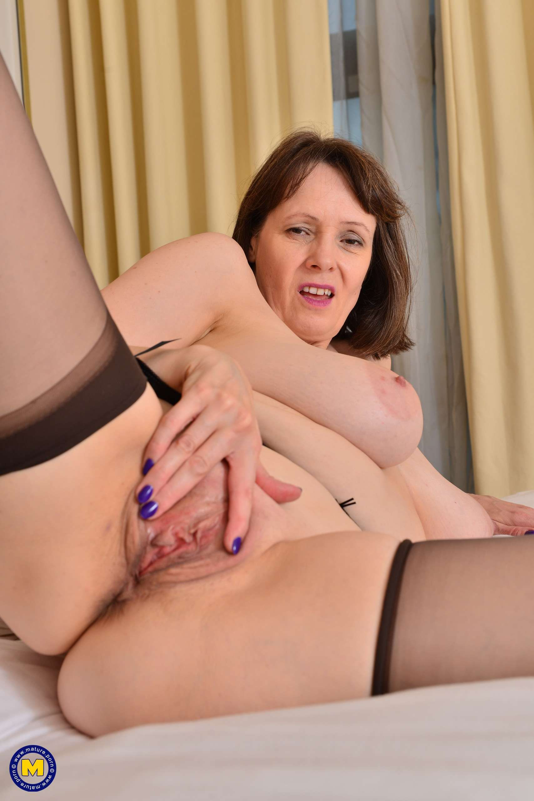 Big breasted housewife Tigger loves to play with her wet pussy