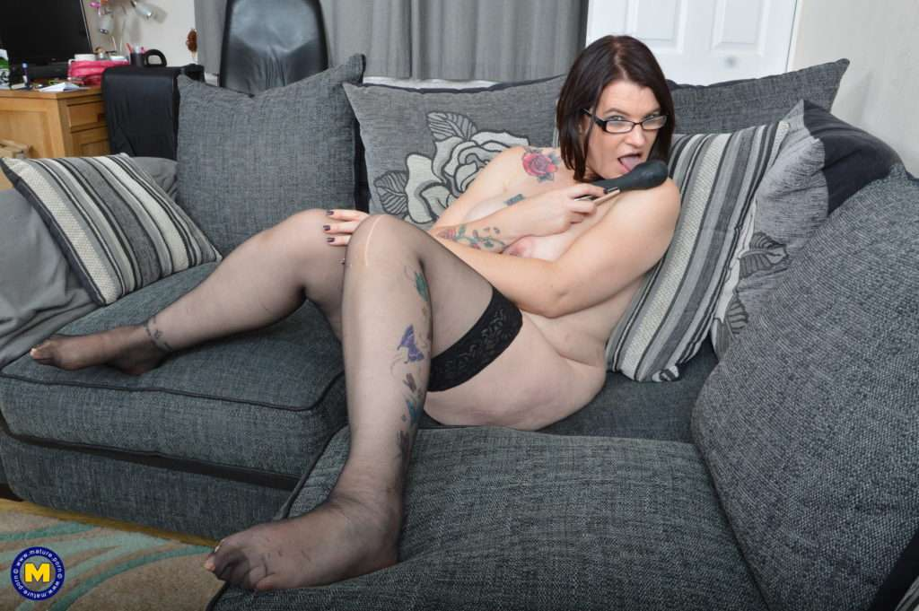 Naughty British Mature Lady Playing On Her Couch At Mature.nl