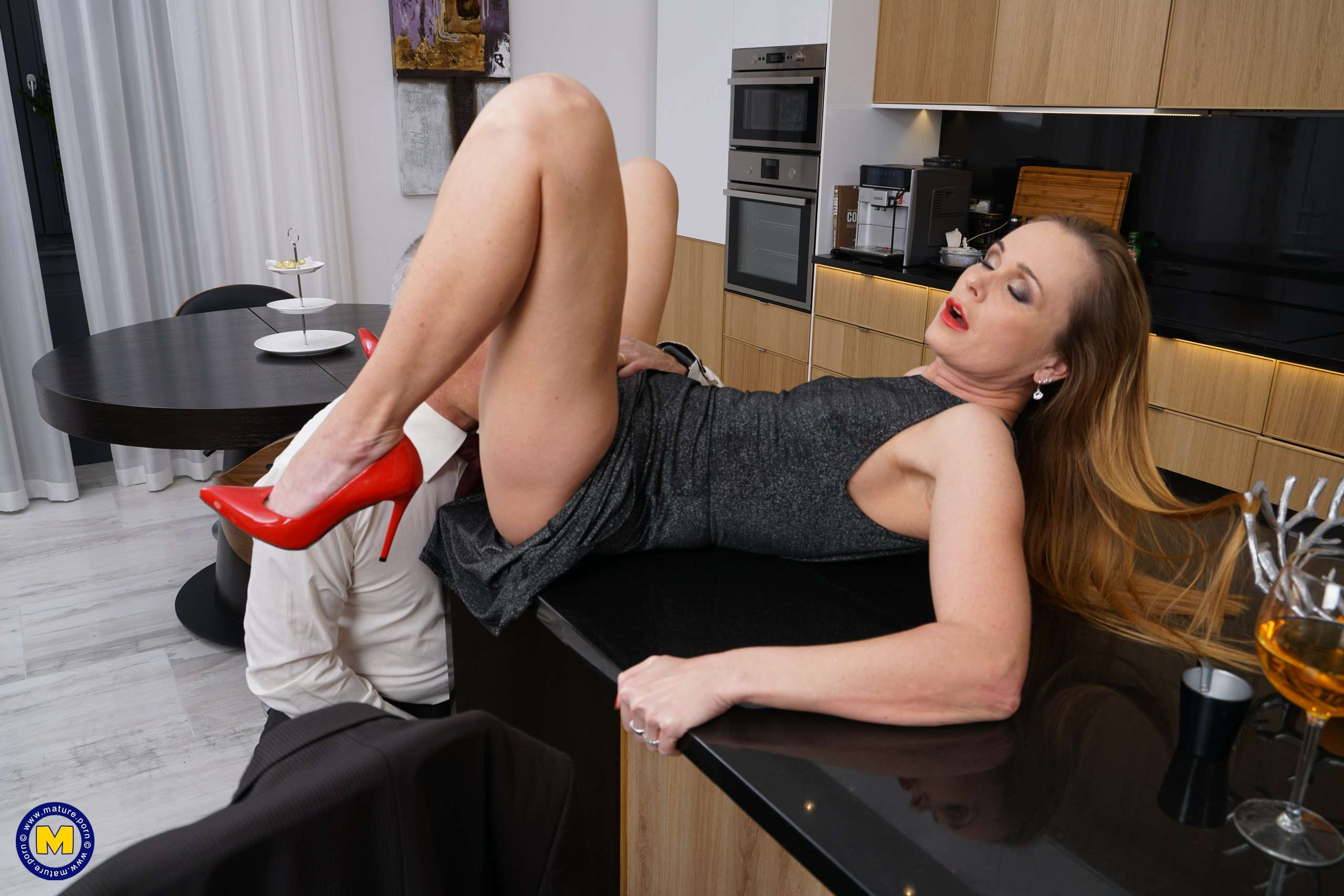 Naughty housewife Nika getting busy in her kitchen