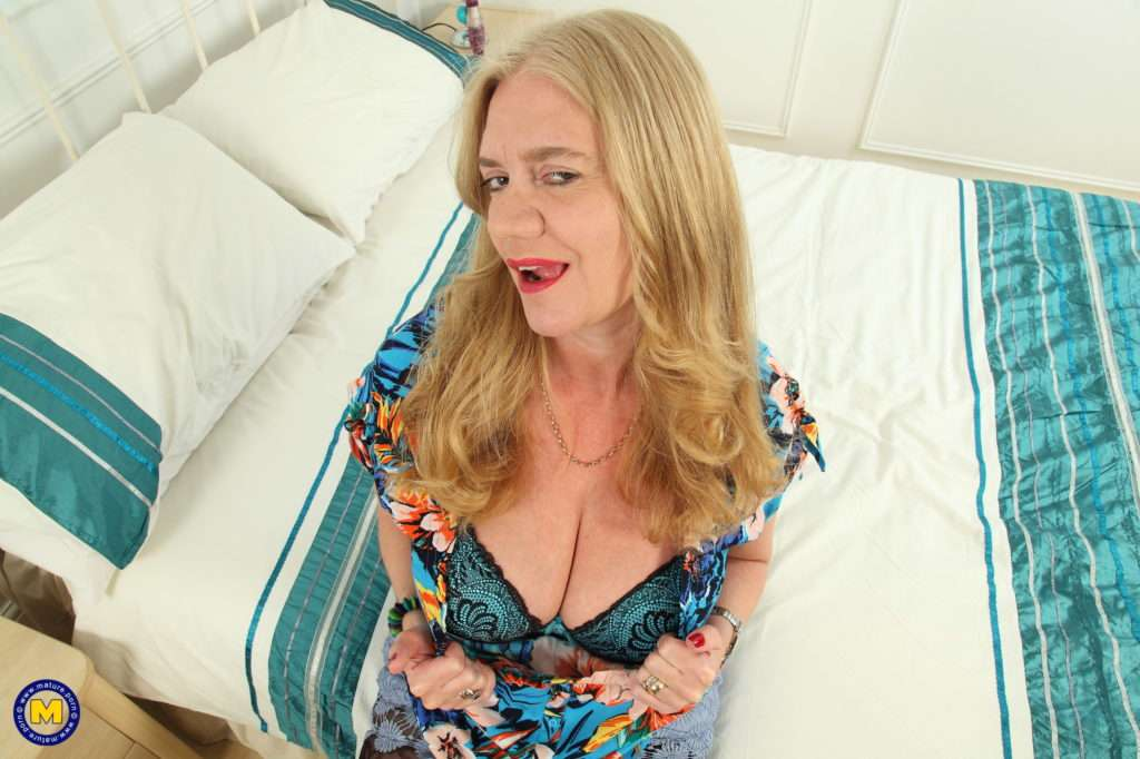 Big Breasted Lily May Loves To Play With Her Toy At Mature.nl