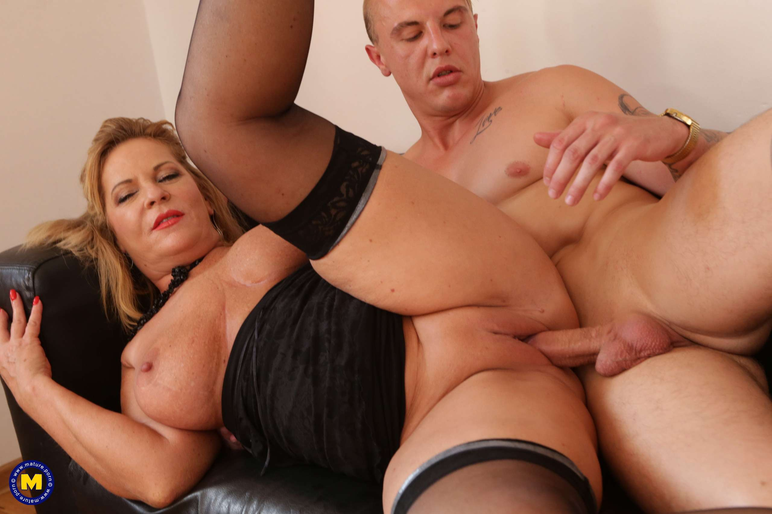 Naughty mature lady fucking a toy boy to the bone