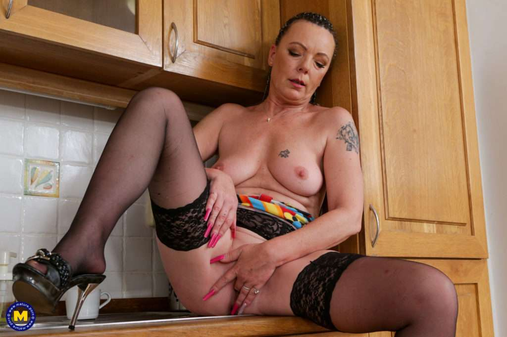 Naughty Shaved Housewife Playing With He Pussy In The Kitchen At Mature.nl