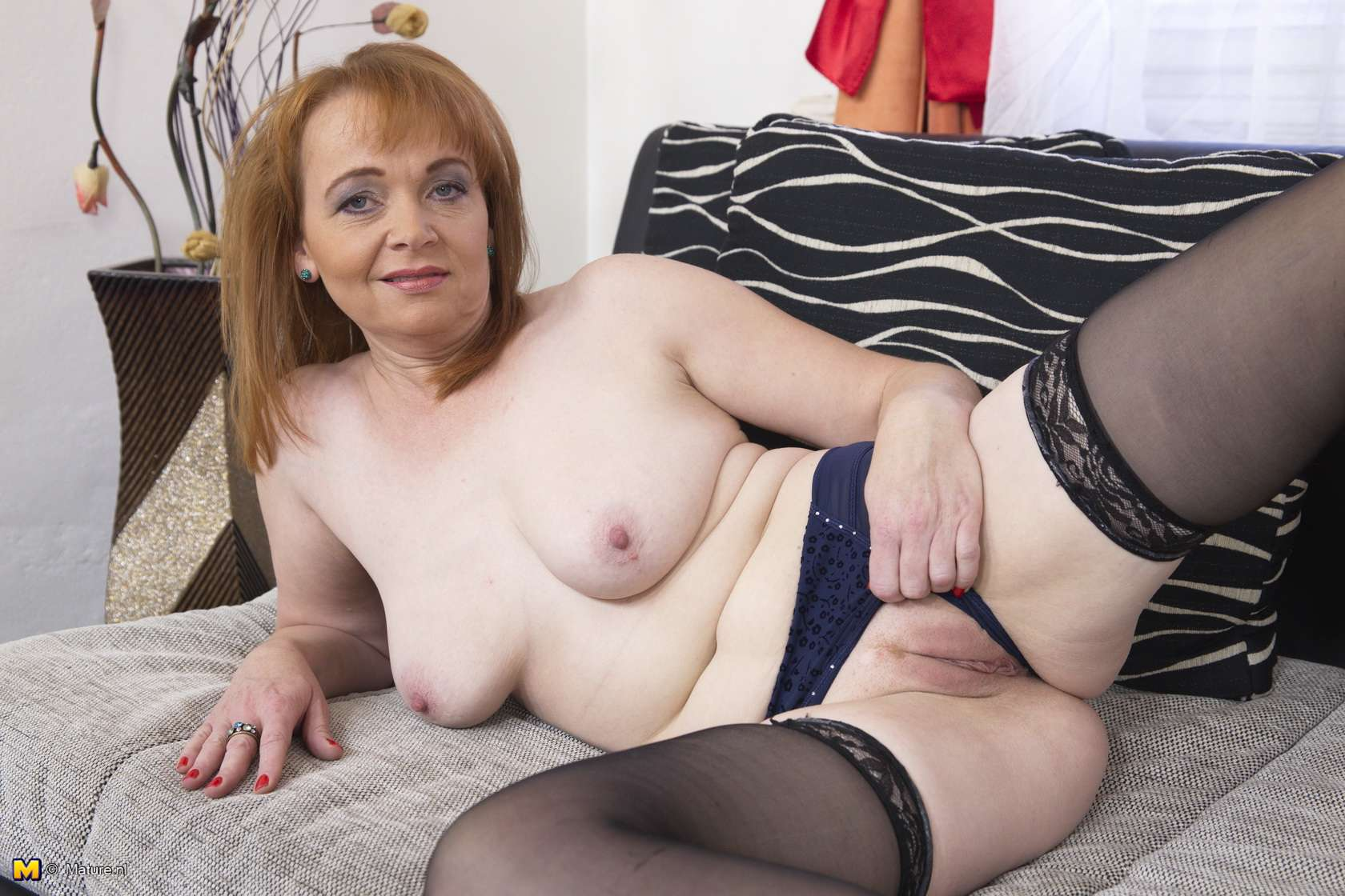 Naughty mature lady playing with her dildo