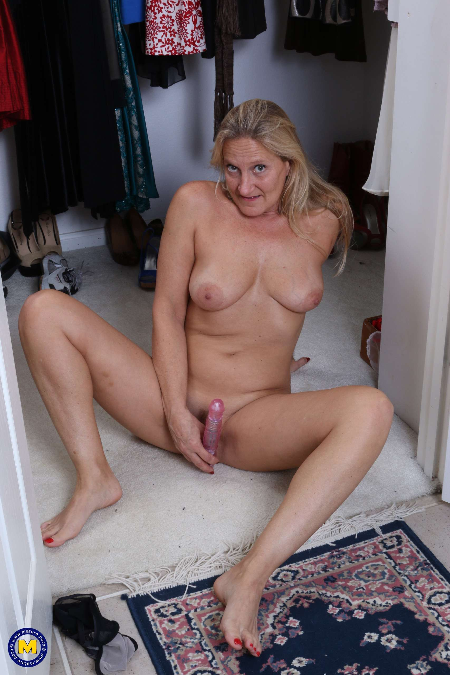 Naughty American mature lady playing with her pussy