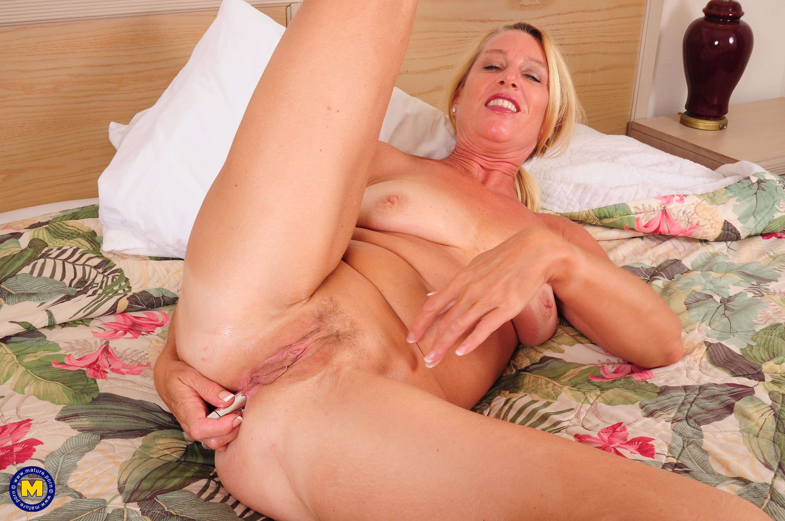 Naughty American housewife playing in her hotelroom with her pussy