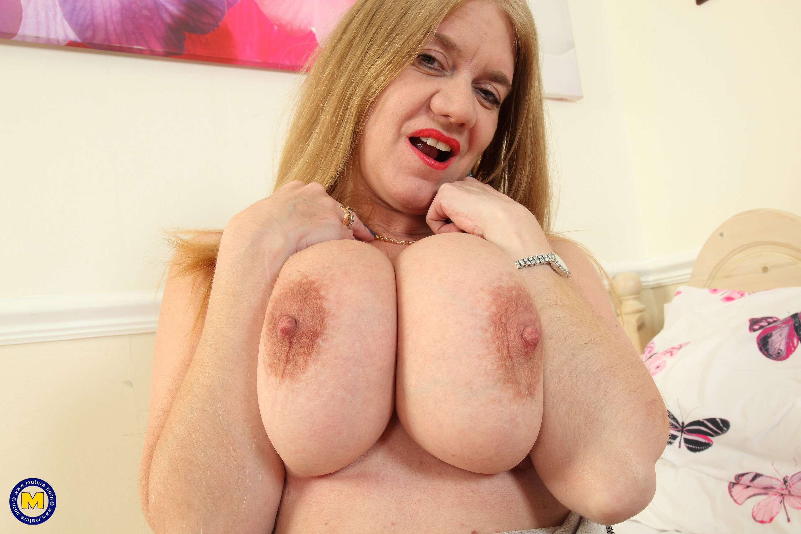 Big breasted housewife Lily May playing with herself