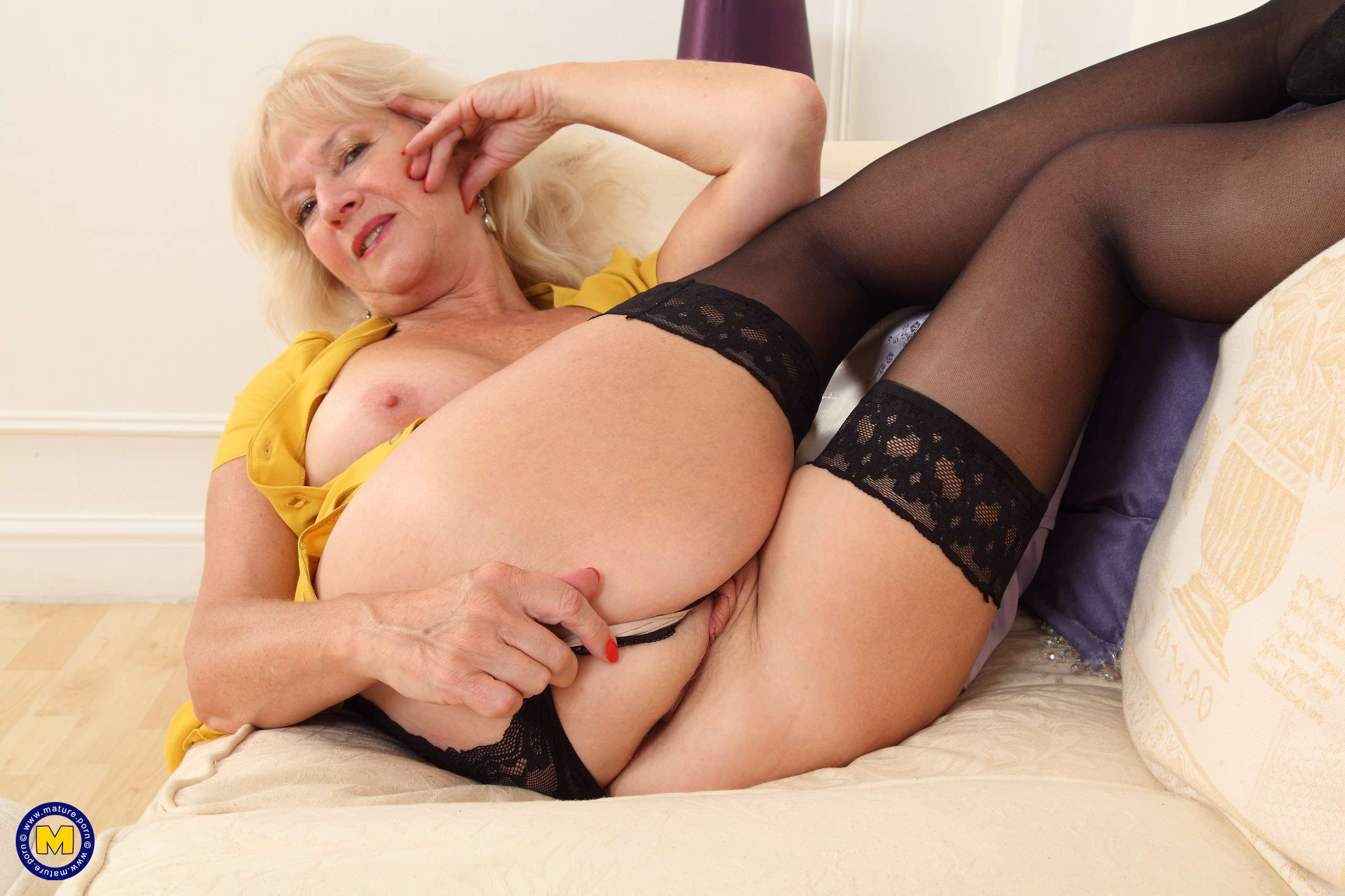 Naughty cougar Emily Jane playing with herself