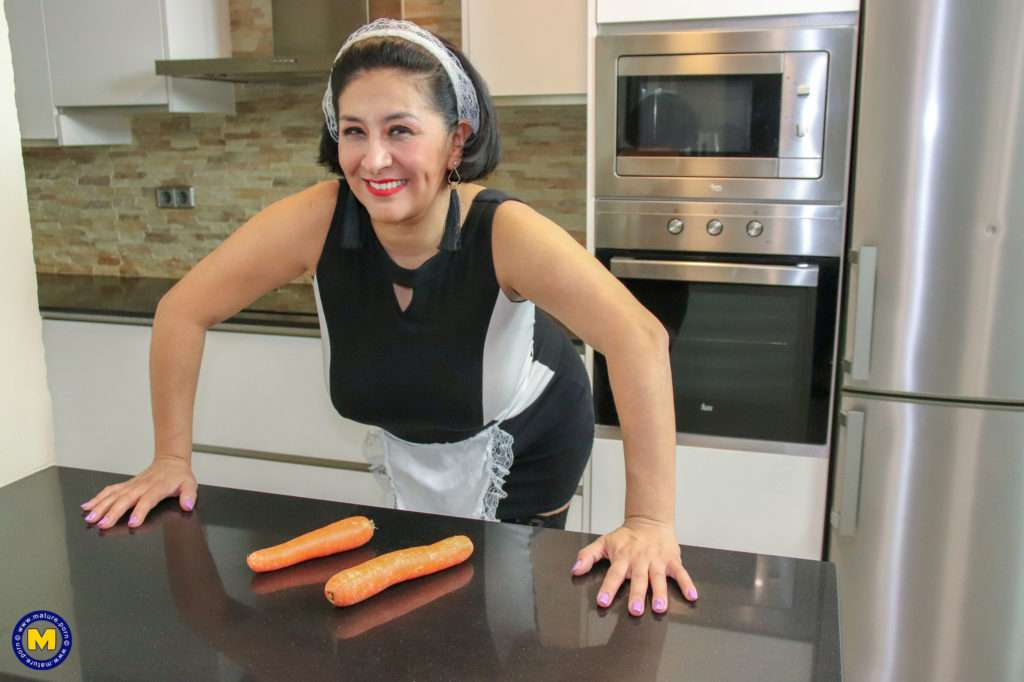 This Spanish Mature Housewmaid Plays With The Carrots From Her Work At Mature.nl