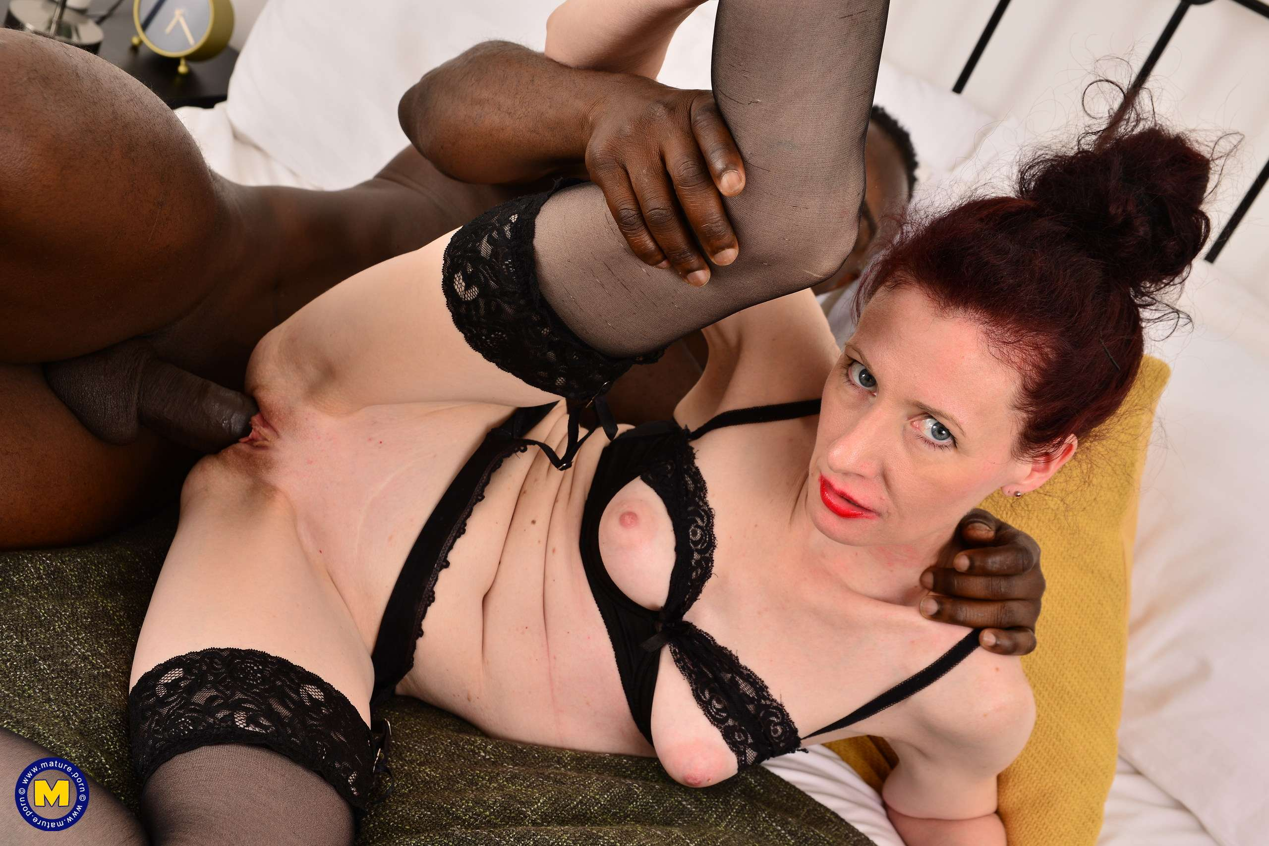Horny British mature lady munching on a big black cock