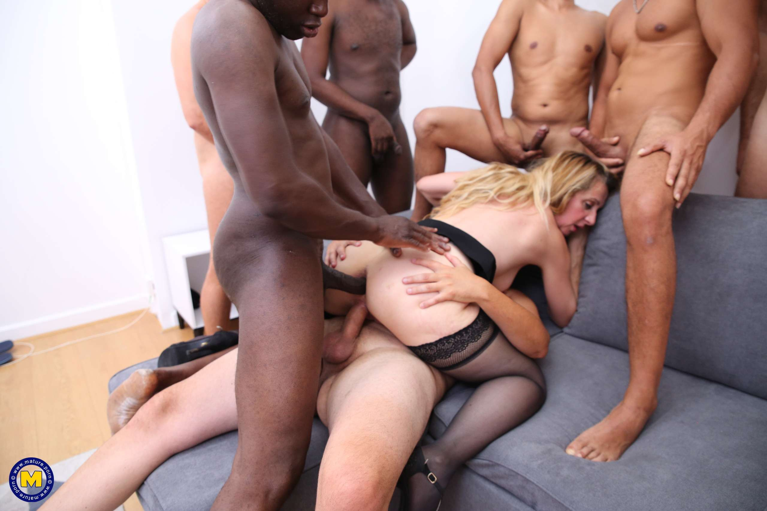 Naughty mature nympho gets all holes filled in this gang bang