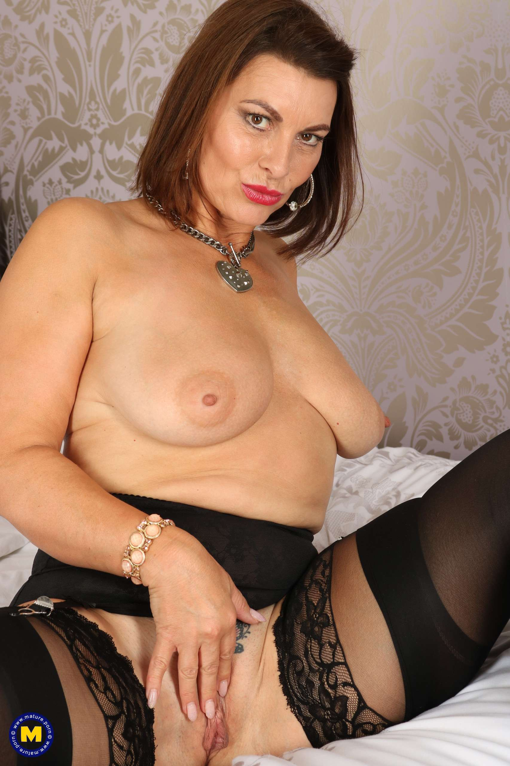 Hot British MILF playing with herself and getting wet