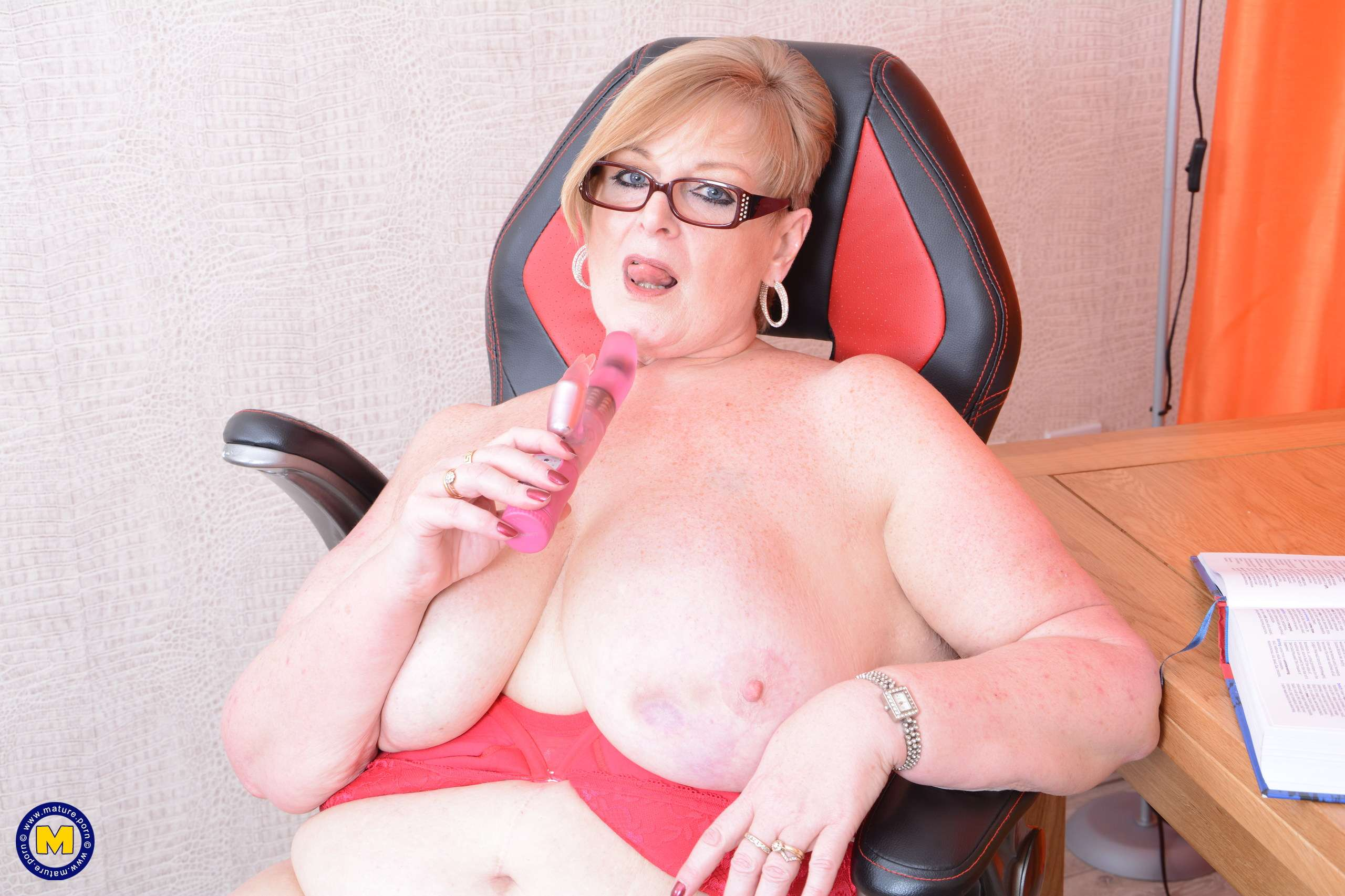 Naughty big lady showing off her huge breasts