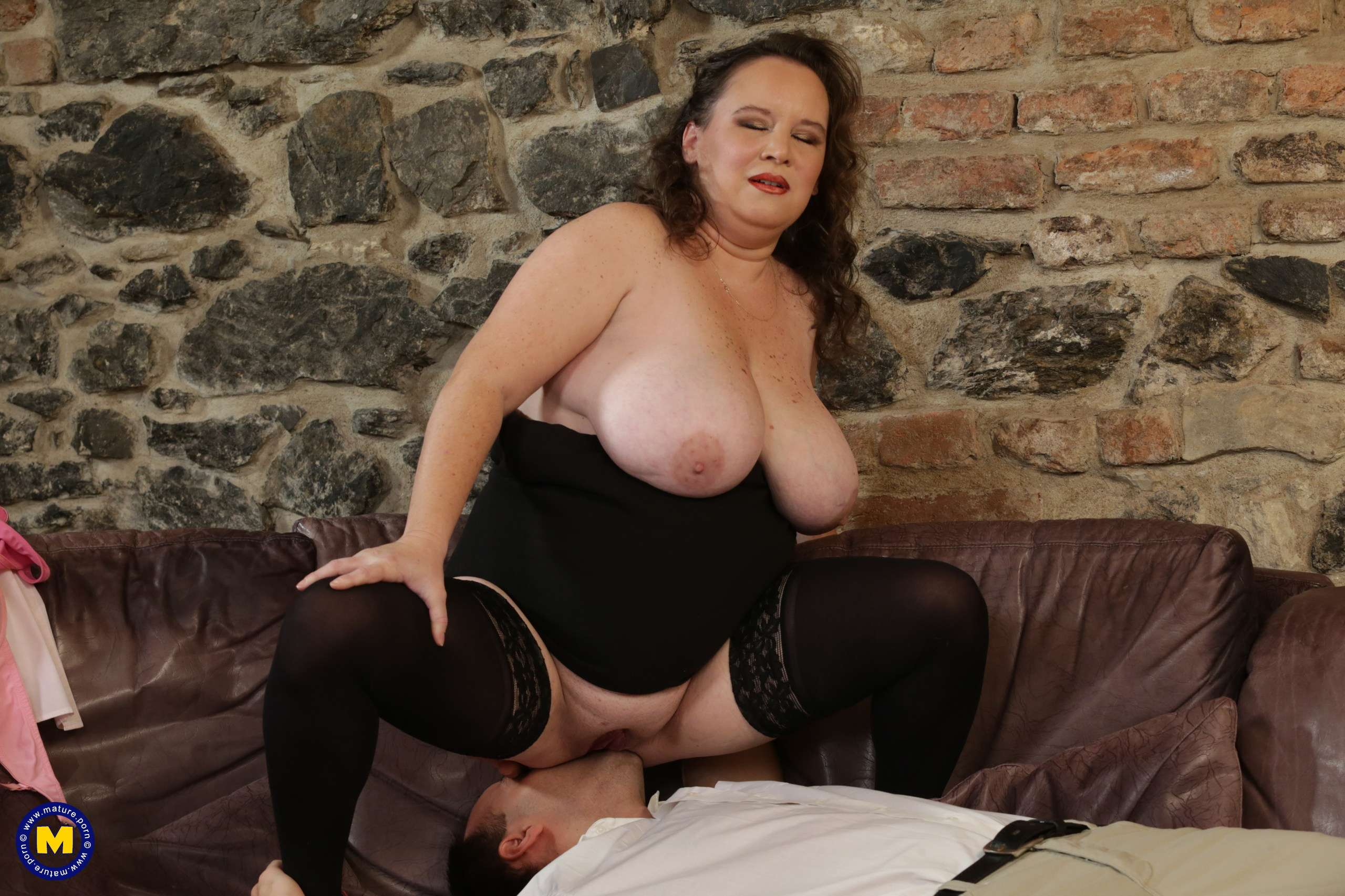 Curvy mature lady having fun with her toy boy