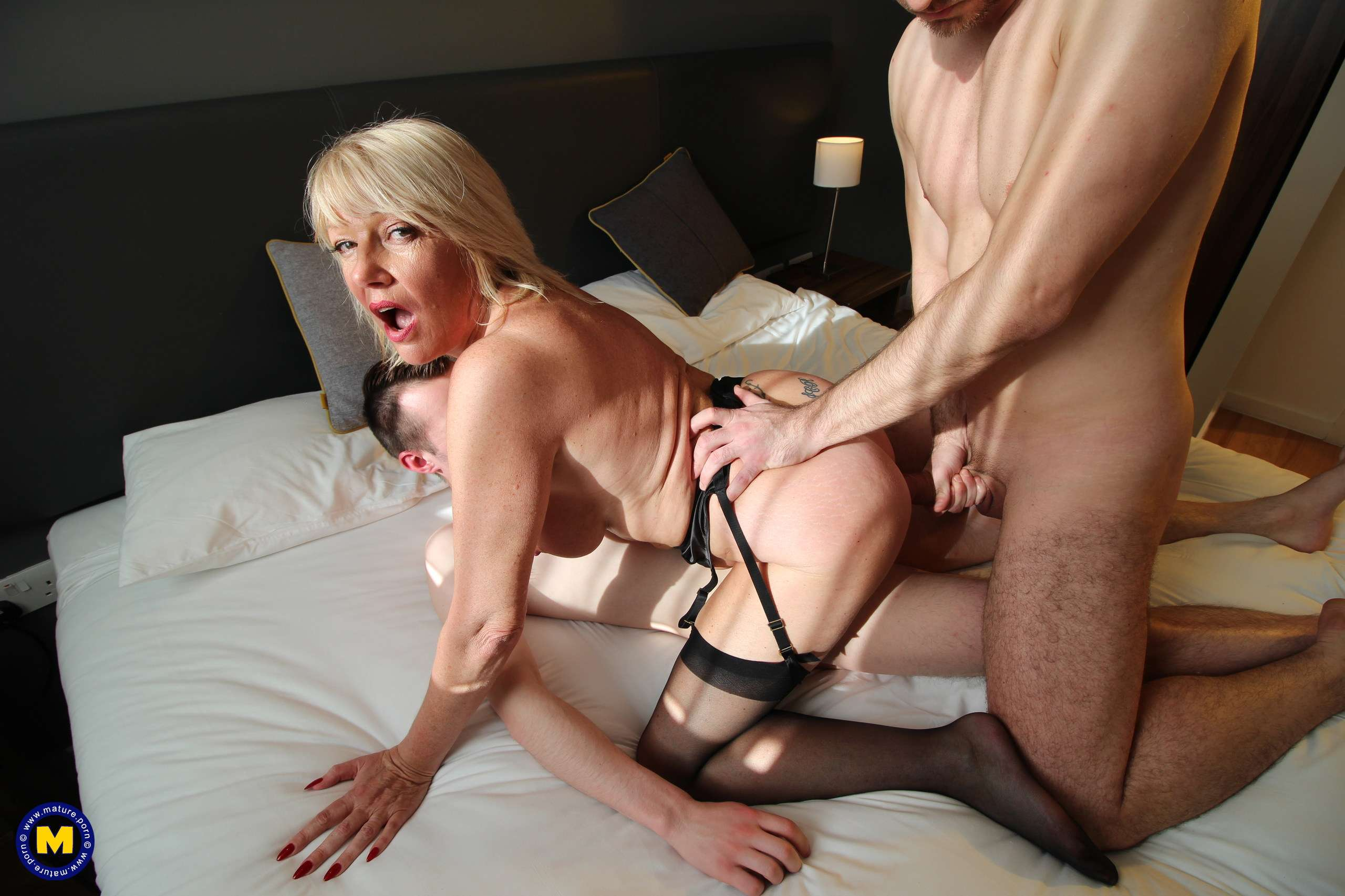 Naughty mature Amy gets a double penetration from two younger guys