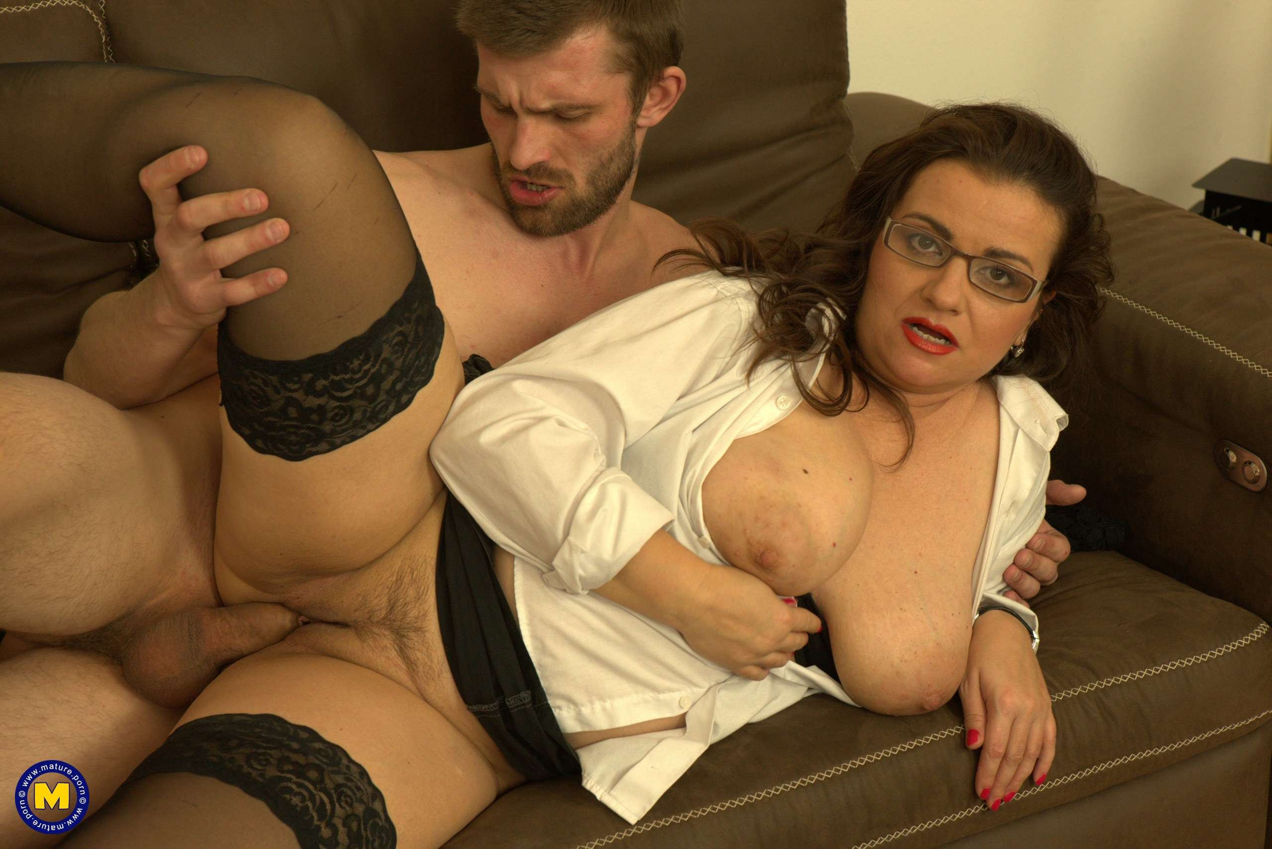 Curvy big breasted mature lady having fun with her younger lover