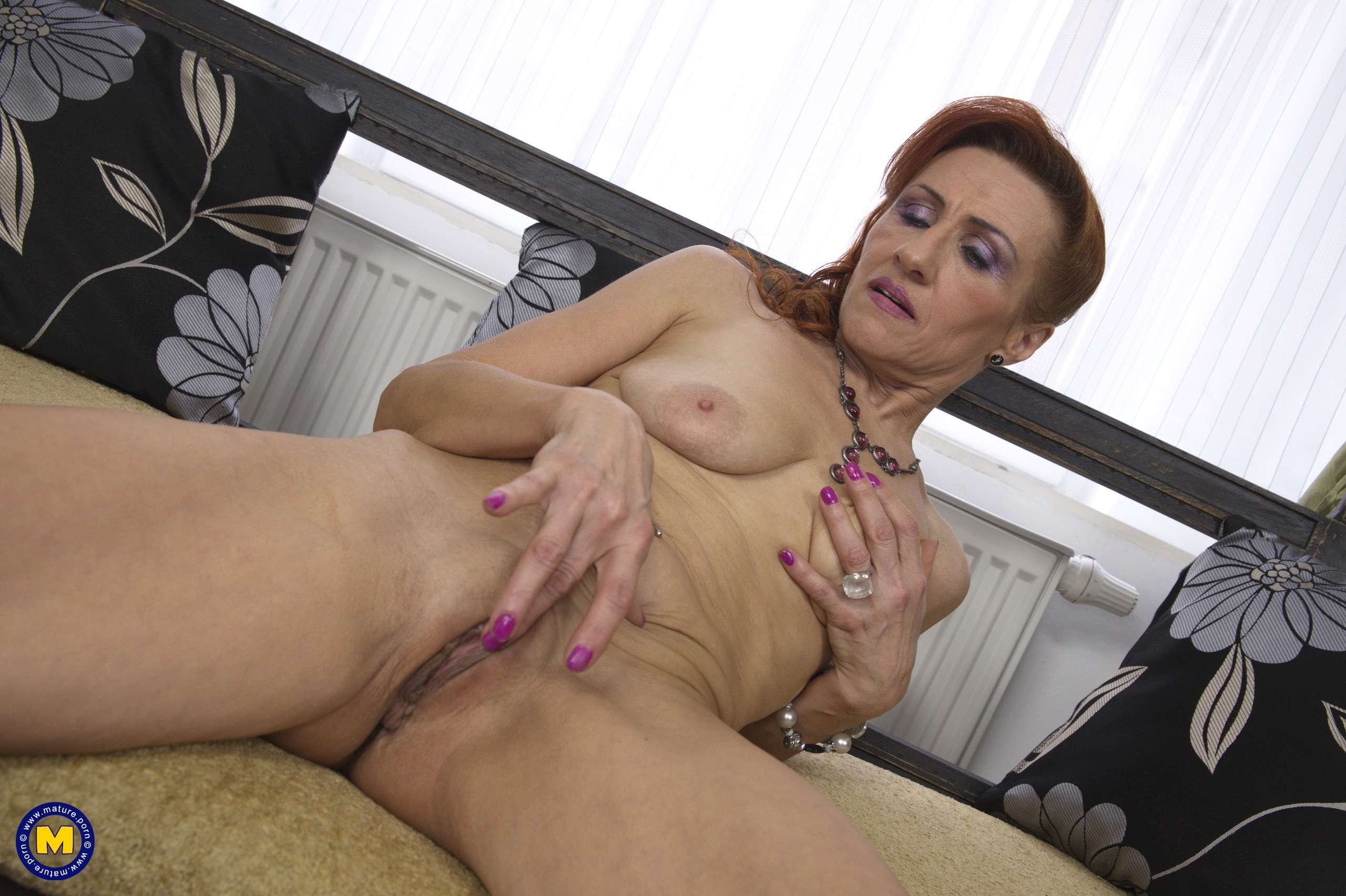 Shaved mature slut playing with her pussy