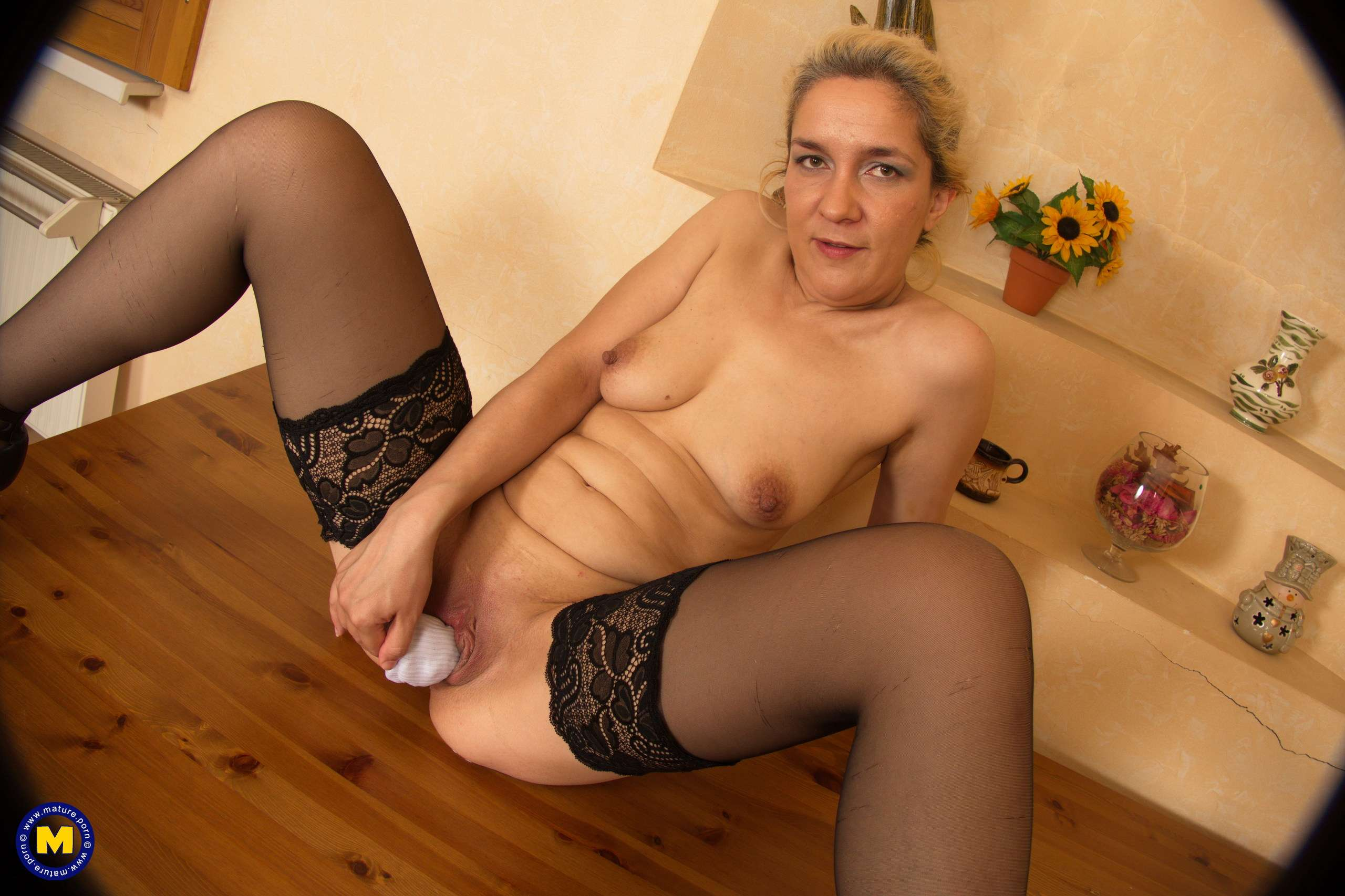 This housewife loves a good long dildo