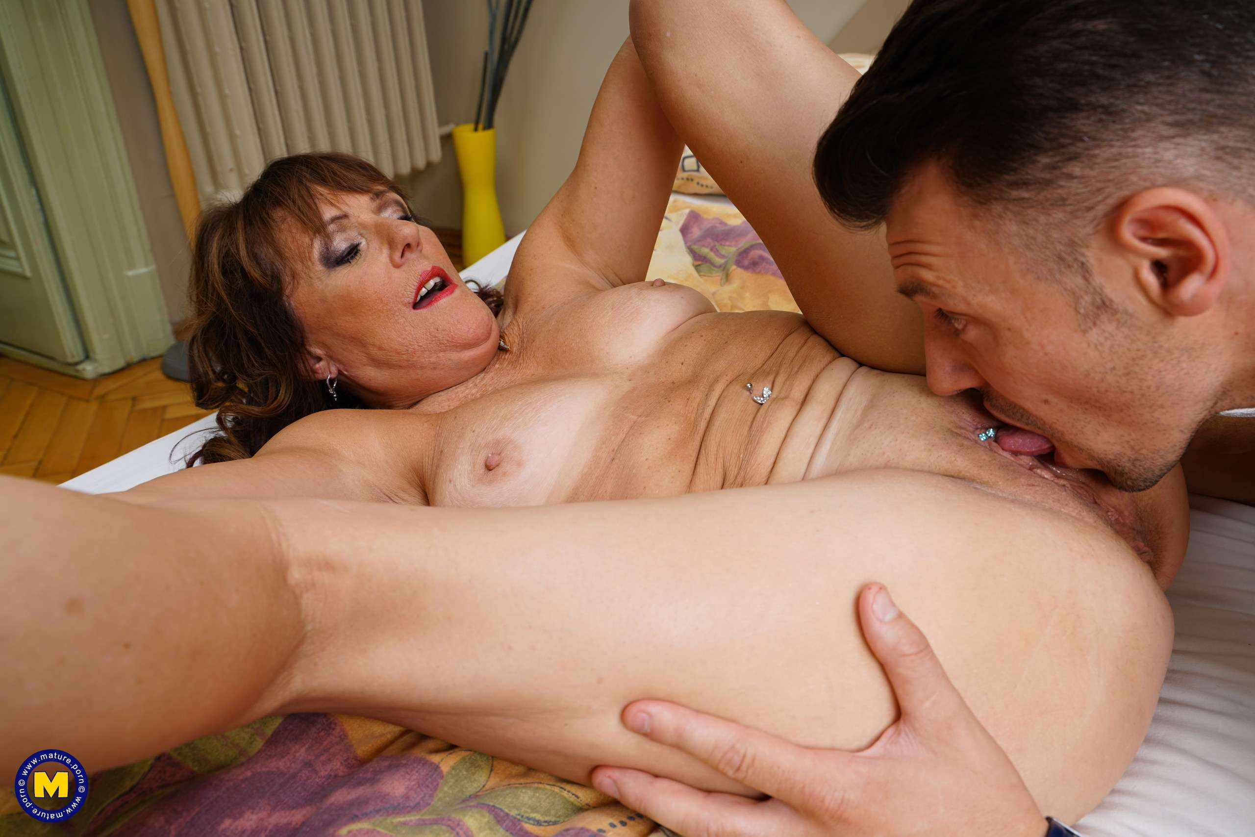 Naughty mature Pandora fooling around with her toy boy