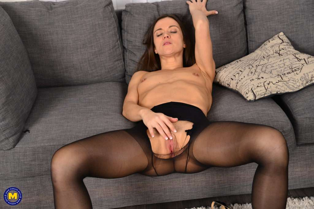 Naughty Pantymom Playing With Herself On The Couch