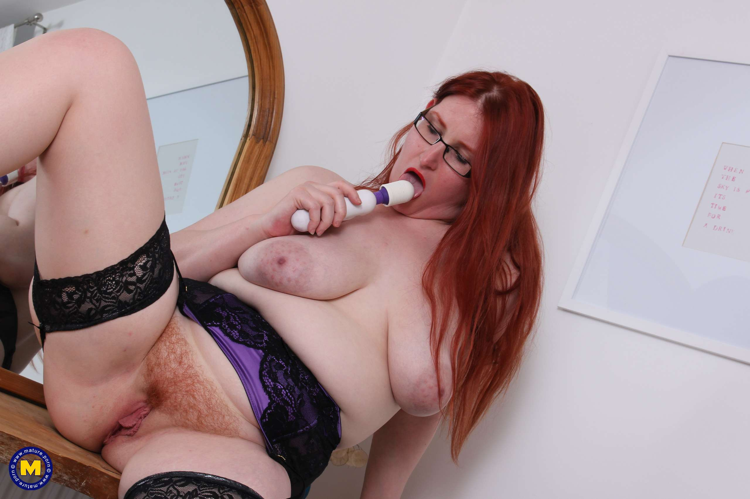 Curvy mature redhead playing with her hairy pussy