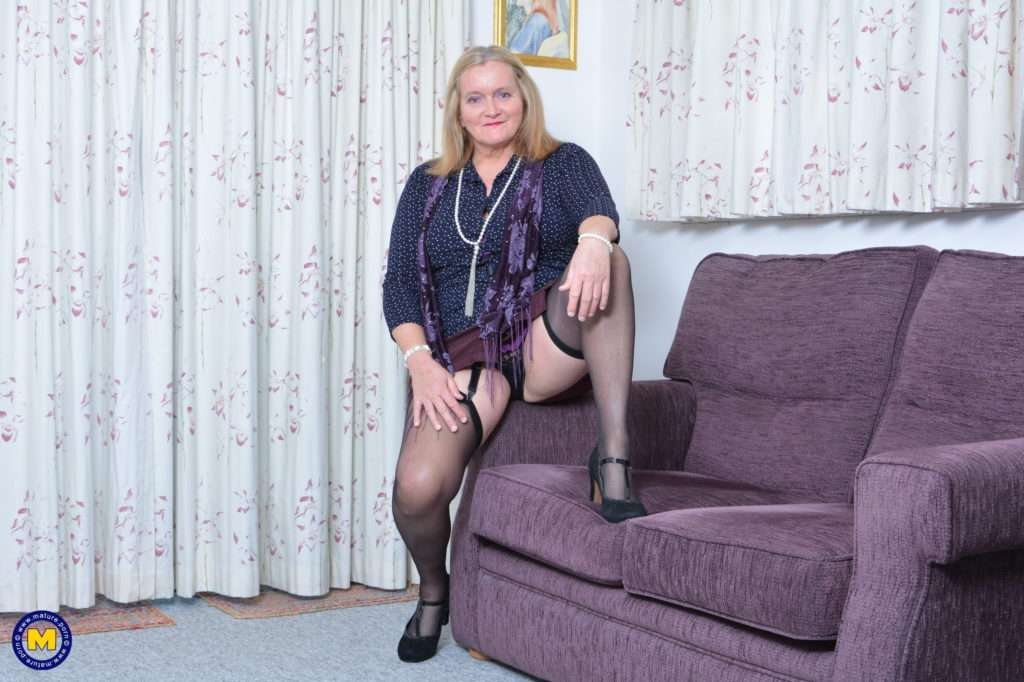 British Mature Lady Playing On The Couch