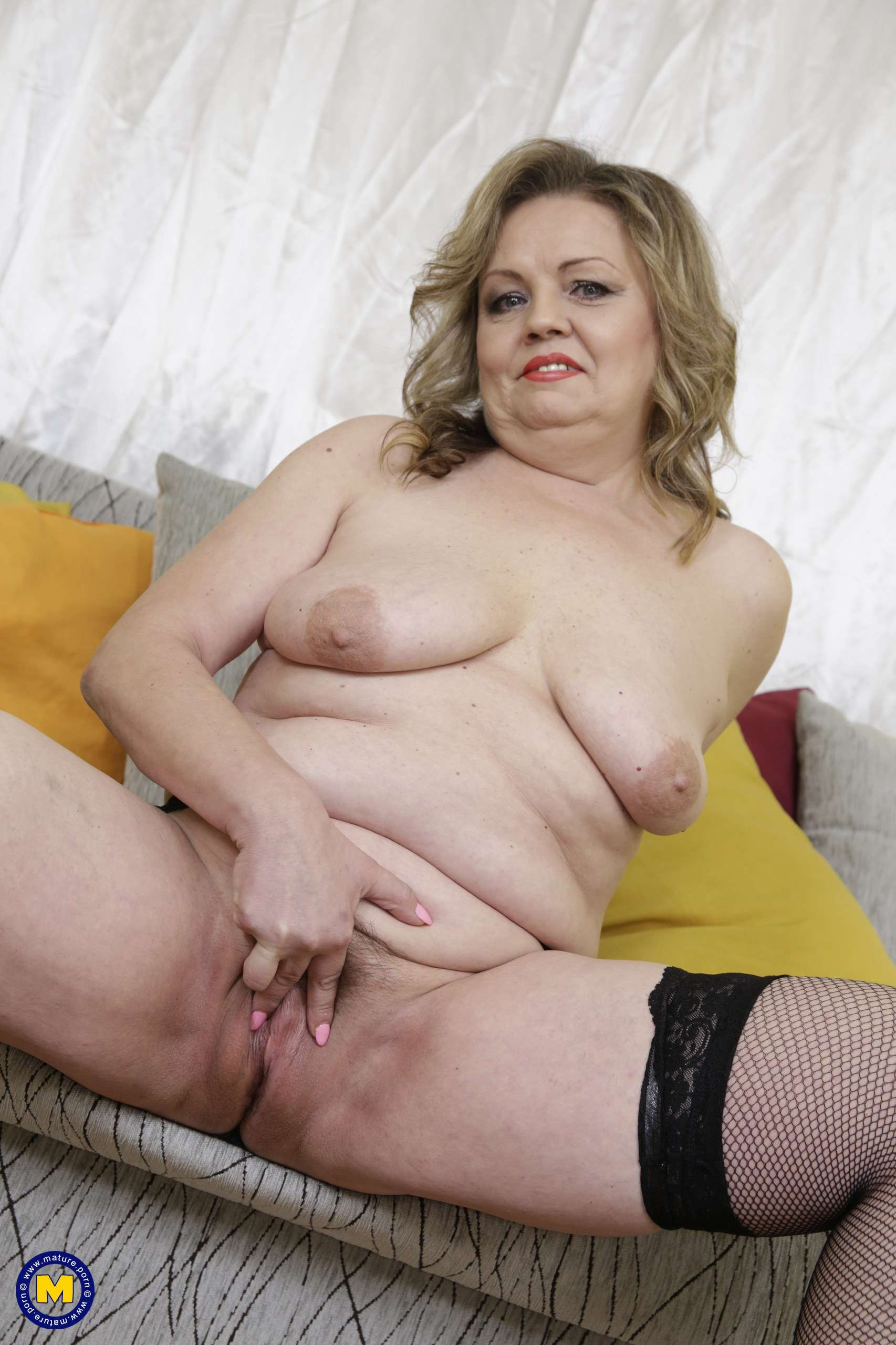 Naughty mature lady showing her unshaved pussy