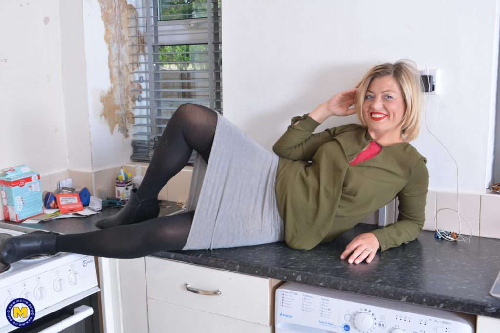 Naughty British Housewife Getting Wet In Her Kitchen