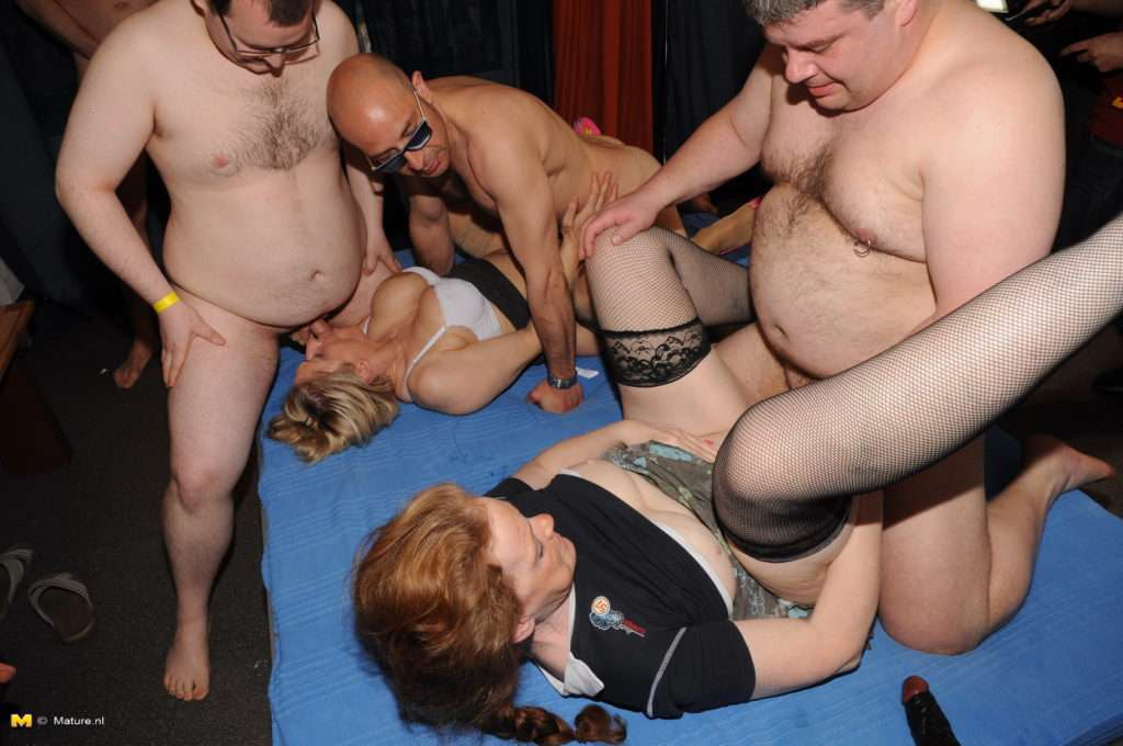 Two Amateur Mature Sluts Are The Centerpiece In This Gang Bang