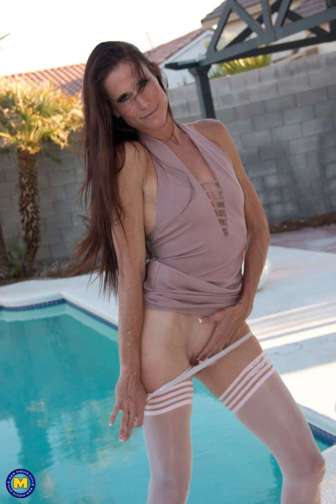 This Naughty Tall Milf Loves To Play With Her Pussy In The Sun