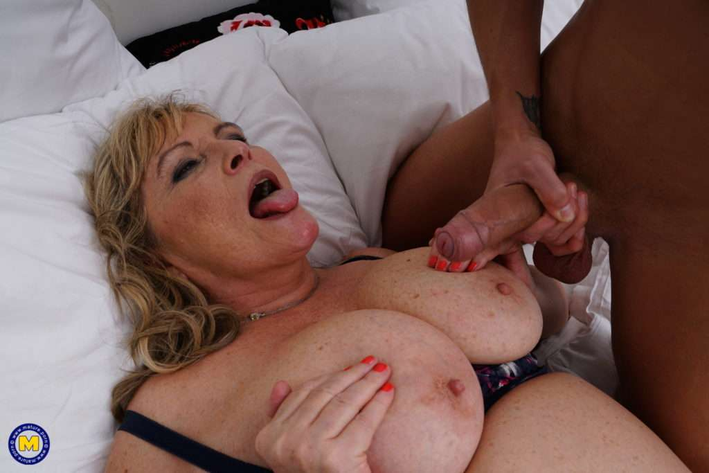 Big Breasted Lady Next Door Gets A Visit From Her Young Neighbour And Seduces Him For A Tasty Afternoon