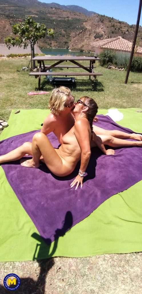 Two Mature Lesbians Are Licking In An Open Field In The Sun