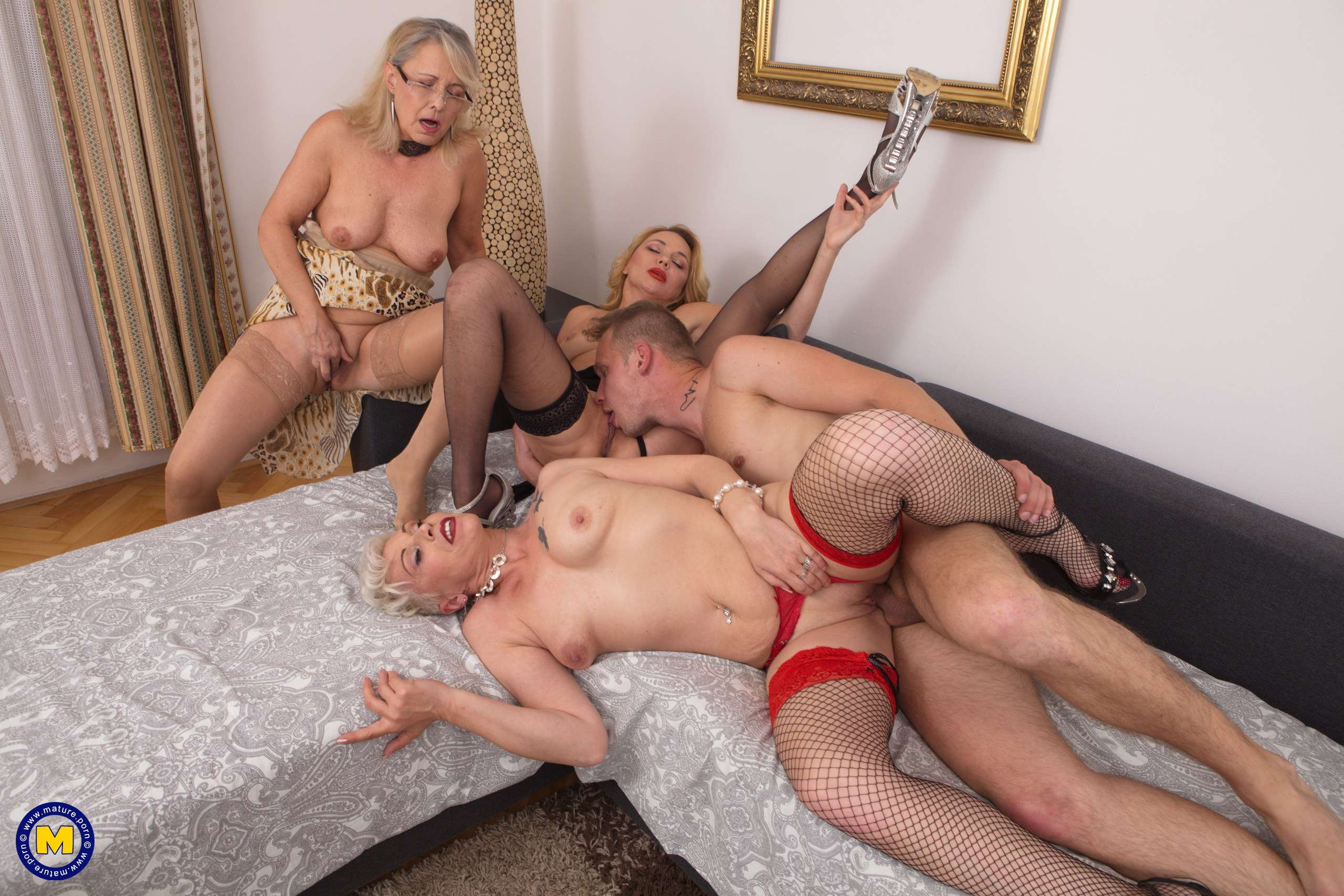 Three horny mature sluts share one lucky toyboy