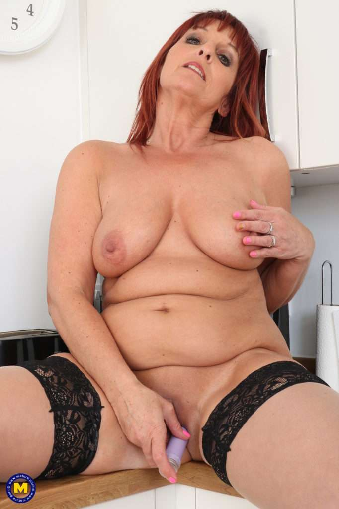 Horny Cougar Masturbating In Her Kitchen